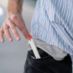 Hemplucid Delta 8 Disposable Vape Pens - 820mg D8 - Strawberry Blast Putting in Pocket