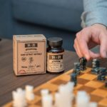 Broad Spectrum CBD Softgels 30mg - 34ct _ R+R Medicinals - Bottle Next To Chess Board